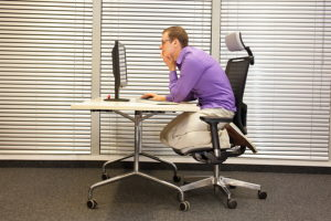 Sit up straight to avoid neck pain