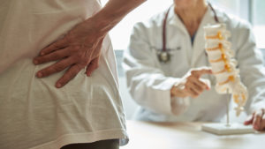 Pain in the lumbar spine can be a herniated disk.